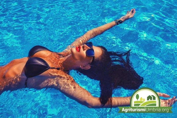 woman relaxing in a Farmhouse swimming pool umbria